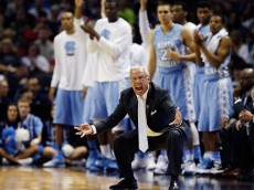 SAN ANTONIO, TX - MARCH 23:  Head coach Roy Williams of the North Carolina Tar Heels reacts during the third round of the 2014 NCAA Men's Basketball Tournament against the Iowa State Cyclones at the AT&T Center on March 23, 2014 in San Antonio, Texas.  (Photo by Tom Pennington/Getty Images)