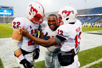 EAST HARTFORD, CT - DECEMBER 06: Cameron Nwosu #52 of the SMU Mustangs celebrates with teammates Hayden Greenbrauer #22 and Ryheem Malone #13 following their win against the Connecticut Huskies at Rentschler Field on December 6, 2014 in East Hartford, Connecticut.  (Photo by Jared Wickerham/Getty Images)