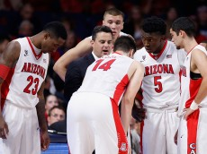 TUCSON, AZ - DECEMBER 09:  Head coach Sean Miller of the Arizona Wildcats talks with Rondae Hollis-Jefferson #23, Dusan Ristic #14, Stanley Johnson #5 and Elliott Pitts #24 in the huddle during the second half of the college basketball game against the Utah Valley Wolverines at McKale Center on December 9, 2014 in Tucson, Arizona. The Wildcats defeated the Wolverines 87-56. (Photo by Christian Petersen/Getty Images)