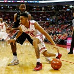 COLUMBUS, OH - MARCH 1:  D'Angelo Russell #0 of the Ohio State Buckeyes drives the ball past Rapheal Davis #35 of the Purdue Boilermakers during the second half at Value City Arena on March 1, 2015 in Columbus, Ohio. Ohio State defeated Purdue 65-61. (Photo by Kirk Irwin/Getty Images)
