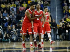 ANN ARBOR, MI - FEBRUARY 22:  D'Angelo Russell #0 of the Ohio State Buckeyes is consoled by Keita Bates-Diop #33 of the Ohio State Buckeyes after turning over the ball during the second half of a game against the Michigan Wolverines at Crisler Arena on February 22, 2015 in Ann Arbor, Michigan. Michigan defeated Ohio State 64-57. (Photo by Duane Burleson/Getty Images)