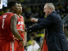 ANN ARBOR, MI - FEBRUARY 22:  Head coach Thad Matta of the Ohio State Buckeyes talks with Jae'Sean Tate #1 of the Ohio State Buckeyes and Marc Loving #2 of the Ohio State Buckeyes during the second half of a game against the Michigan Wolverines at Crisler Arena on February 22, 2015 in Ann Arbor, Michigan. Michigan defeated Ohio State 64-57. (Photo by Duane Burleson/Getty Images)