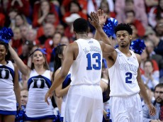 GREENSBORO, NC - MARCH 12:  Matt Jones #13 high-fives Quinn Cook #2 of the Duke Blue Devils during a win against the North Carolina State Wolfpack during the quarterfinals of the ACC Basketball Tournament at Greensboro Coliseum on March 12, 2015 in Greensboro, North Carolina.  (Photo by Grant Halverson/Getty Images)