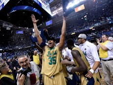 GREENSBORO, NC - MARCH 14:  Bonzie Colson #35 and the Notre Dame Fighting Irish celebrate after defeating the North Carolina Tar Heels during the championship game of the ACC Basketball Tournament at Greensboro Coliseum on March 14, 2015 in Greensboro, North Carolina. Notre Dame won 90-82.  (Photo by Grant Halverson/Getty Images)