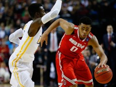PORTLAND, OR - MARCH 19:  D'Angelo Russell #0 of the Ohio State Buckeyes dribbles past JeQuan Lewis #1 of the Virginia Commonwealth Rams in the first half during the second round of the 2015 NCAA Men's Basketball Tournament at Moda Center on March 19, 2015 in Portland, Oregon.  (Photo by Jonathan Ferrey/Getty Images)