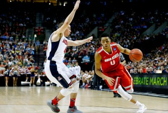 PORTLAND, OR - MARCH 21:  D'Angelo Russell #0 of the Ohio State Buckeyes drives against T.J. McConnell #4 of the Arizona Wildcats in the second half during the third round of the 2015 NCAA Men's Basketball Tournament at Moda Center on March 21, 2015 in Portland, Oregon.  (Photo by Jonathan Ferrey/Getty Images)