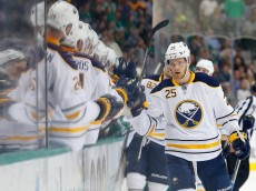DALLAS, TX - MARCH 23:  Mikhail Grigorenko #25 of the Buffalo Sabres celebrates with his team after scoring against the Dallas Stars in the first period at American Airlines Center on March 23, 2015 in Dallas, Texas.  (Photo by Tom Pennington/Getty Images)