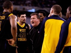 INDIANAPOLIS - APRIL 03:  Head coach Bob Huggins of the West Virginia Mountaineers yells at his players during a timeout in the first half against the Duke Blue Devils during the National Semifinal game of the 2010 NCAA Division I Men's Basketball Championship at Lucas Oil Stadium on April 3, 2010 in Indianapolis, Indiana.  (Photo by Andy Lyons/Getty Images)
