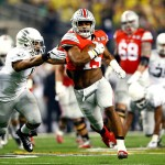 ARLINGTON, TX - JANUARY 12:  Running back Ezekiel Elliott #15 of the Ohio State Buckeyes runs the ball 33 yards to score a touchdown in the first quarter against the Oregon Ducks during the College Football Playoff National Championship Game at AT&T Stadium on January 12, 2015 in Arlington, Texas.  (Photo by Kevin C. Cox/Getty Images)