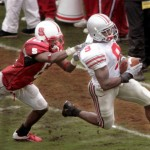 RALEIGH, NC - SEPTEMBER 18:  Donte Whitner #9 of the Ohio State Buckeyes returns an interception against Richard Washington #6 of the North Carolina State University Wolfpack during a game on September 18, 2004, at Carter-Finley Stadium in Raleigh, North Carolina. (Photo By Grant Halverson/Getty Images)