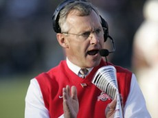 Head coach Jim Tressel of the Ohio State Buckeyes encourages the team during action against the Michigan Wolverines at Michigan Stadium in Ann Arbor, Michigan on November 19, 2005.  Ohio State won 25-21. (Photo by G. N. Lowrance/Getty Images)