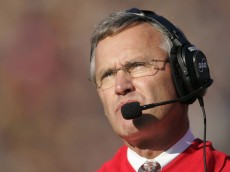 Head coach Jim Tressel of the Ohio State Buckeyes checks out the scoreboard during action against the Michigan Wolverines at Michigan Stadium in Ann Arbor, Michigan on November 19, 2005.  Ohio State won 25-21. (Photo by G. N. Lowrance/Getty Images)