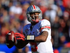 JACKSONVILLE, FL - JANUARY 02:  Quaterback Braxton Miller #5 of Ohio State Buckeyes looks to pass during the first half at the TaxSlayer.com Gator Bowl against the Florida Gators at EverBank Field on January 2, 2012 in Jacksonville, Florida.  (Photo by Scott Halleran/Getty Images)