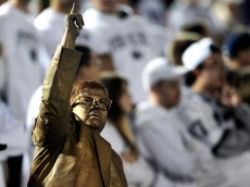 STATE COLLEGE, PA - OCTOBER 27: A Penn State Nittany Lions fan dressed up as former Penn State football coach Joe Paterno's statue poses to other fans in the crowd during a game against the Ohio State Buckeyes at Beaver Stadium on October 27, 2012 in State College, Pennsylvania. The Ohio State Buckeyes won, 35-23. (Photo by Patrick Smith/Getty Images)
