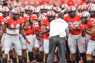 COLUMBUS, OH - SEPTEMBER 6:  Head Coach Urban Meyer of the Ohio State Buckeyes rallies his team before a game against the Virginia Tech Hokies at Ohio Stadium on September 6, 2014 in Columbus, Ohio.  (Photo by Jamie Sabau/Getty Images)