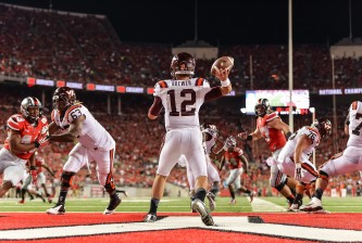 COLUMBUS, OH - SEPTEMBER 6:  Quarterback Michael Brewer #12 of the Virginia Tech Hokies passes against the Ohio State Buckeyes at Ohio Stadium on September 6, 2014 in Columbus, Ohio.  (Photo by Jamie Sabau/Getty Images)