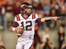COLUMBUS, OH - SEPTEMBER 6:  Quarterback Michael Brewer #12 of the Virginia Tech Hokies runs with the ball against the Ohio State Buckeyes at Ohio Stadium on September 6, 2014 in Columbus, Ohio.  (Photo by Jamie Sabau/Getty Images)