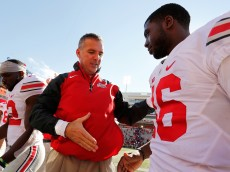 COLLEGE PARK, MD - OCTOBER 04:  Head coach Urban Meyer of the Ohio State Buckeyes (L) shakes hands with quarterback J.T. Barrett #16 (R) after their 52-24 win over the Maryland Terrapins at Byrd Stadium on October 4, 2014 in College Park, Maryland.  (Photo by Jonathan Ernst/Getty Images)