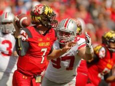 COLLEGE PARK, MD - OCTOBER 04:  Defensive end Joey Bosa #97 (R) of the Ohio State Buckeyes closes in on quarterback Caleb Rowe #7 (L) of the Maryland Terrapins during the second half of their game at Byrd Stadium on October 4, 2014 in College Park, Maryland.  (Photo by Jonathan Ernst/Getty Images)