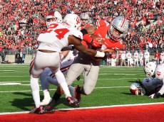 COLUMBUS, OH - NOVEMBER 22:  Jalin Marshall #17 of the Ohio State Buckeyes scores on a six-yard touchdown pass reception in the fourth quarter against the Indiana Hoosiers at Ohio Stadium on November 22, 2014 in Columbus, Ohio. Marshall scored four touchdowns in the second half to pace Ohio State to a 42-27 victory over Indiana.  (Photo by Jamie Sabau/Getty Images)