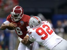 NEW ORLEANS, LA - JANUARY 01:  Blake Sims #6 of the Alabama Crimson Tide gets tackled by Adolphus Washington #92 of the Ohio State Buckeyes  during the All State Sugar Bowl at the Mercedes-Benz Superdome on January 1, 2015 in New Orleans, Louisiana.  (Photo by Chris Graythen/Getty Images)