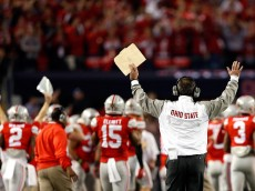 ARLINGTON, TX - JANUARY 12:  Head Coach Urban Meyer of the Ohio State Buckeyes reacts after a play in the fourth quarter against the Oregon Ducks during the College Football Playoff National Championship Game at AT&T Stadium on January 12, 2015 in Arlington, Texas.  (Photo by Christian Petersen/Getty Images)