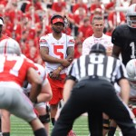 COLUMBUS, OH - APRIL 18:  Quarterbacks J.T. Barrett #16 of the Ohio State Buckeyes and Braxton Miller #5 of the Ohio State Buckeyes watch alongside Head Coach Urban Meyer of the Ohio State Buckeyes as Cardale Jones #12 of the Ohio State Buckeyes runs the offense for the Ohio State Buckeyes Gray team against the Scarlet team at Ohio Stadium on April 18, 2015 in Columbus, Ohio.  (Photo by Jamie Sabau/Getty Images)