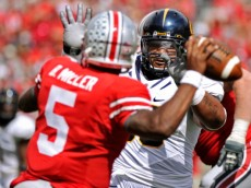 COLUMBUS, OH - SEPTEMBER 15:  Viliami Moala #55 of the California Golden Bears applies pressure to quarterback Braxton Miller #5 of the Ohio State Buckeyes in the second half at Ohio Stadium on September 15, 2012 in Columbus, Ohio.  (Photo by Jamie Sabau/Getty Images)