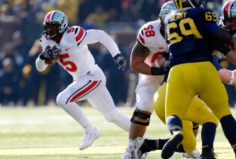 ANN ARBOR, MI - NOVEMBER 30: Quarterback Braxton Miller #5 of the Ohio State Buckeyes runs the ball against the Michigan Wolverines during a game at Michigan Stadium on November 30, 2013 in Ann Arbor, Michigan.  (Photo by Gregory Shamus/Getty Images)