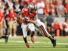 COLUMBUS, OH - SEPTEMBER 6:  Dontre Wilson #2 of the Ohio State Buckeyes runs with the ball  against the Virginia Tech Hokies at Ohio Stadium on September 6, 2014 in Columbus, Ohio.  (Photo by Jamie Sabau/Getty Images)