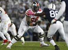 STATE COLLEGE, PA - OCTOBER 25:  Taylor Decker #68 of the Ohio State Buckeyes blocks during the game against the Penn State Nittany Lions on October 25, 2014 at Beaver Stadium in State College, Pennsylvania.  (Photo by Justin K. Aller/Getty Images)