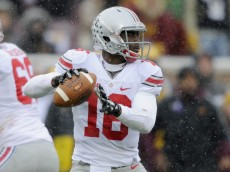 MINNEAPOLIS, MN - NOVEMBER 15: J.T. Barrett #16 of the Ohio State Buckeyes looks to pass the football against the Minnesota Golden Gophers during the second quarter of the game on November 15, 2014 at TCF Bank Stadium in Minneapolis, Minnesota. (Photo by Hannah Foslien/Getty Images)