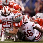 INDIANAPOLIS, IN - DECEMBER 06:  Joey Bosa #97 of the Ohio State Buckeyes tackles Melvin Gordon #25 of the Wisconsin Badgers in the first half of the Big Ten Championship at Lucas Oil Stadium on December 6, 2014 in Indianapolis, Indiana.  (Photo by Joe Robbins/Getty Images)