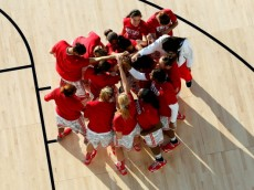 CHARLESTON, SC - NOVEMBER 09:  The Ohio State Buckeyes huddle up prior to playing against the Notre Dame Fighting Irish during the Walmart Carrier Classic on the deck of the USS Yorktown on November 9, 2012 in Charleston, South Carolina.  (Photo by Rob Carr/Getty Images)