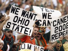 MIAMI - DECEMBER 7:  Fans of the University of Miami Hurricanes want their team to take on the Ohio State University Buckeyes during the game against the Virginia Polytechnic Institute and State University Hokies at the Orange Bowl on December 7, 2002 in Miami, Florida.  The Hurricanes won 56-45. (Photo by Jed Jacobsohn/Getty Images)