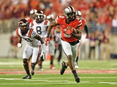 COLUMBUS, OH - SEPTEMBER 6:  Michael Thomas #3 of the Ohio State Buckeyes runs upfield to complete a 53-yard reception for a touchdown in the third quarter against the Virginia Tech Hokies at Ohio Stadium on September 6, 2014 in Columbus, Ohio. Virginia Tech upset Ohio State 35-21.  (Photo by Jamie Sabau/Getty Images)