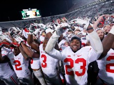 EAST LANSING, MI - NOVEMBER 8: Ohio State Buckeyes players celebrate after a 49-37 win over the Michigan State Spartans at Spartan Stadium on November 8, 2014 in East Lansing, Michigan. (Photo by Joe Robbins/Getty Images)
