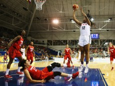 TORONTO, ON - JULY 20:  Stephanie Mavunga of the USA shoots as Lizanne Murphy of Canada falls during the Women's Baskeball Finals at the Pan Am Games on July 20, 2015 in Toronto, Canada.  (Photo by Al Bello/Getty Images)