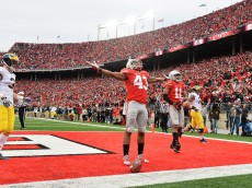 COLUMBUS, OH - NOVEMBER 29:  Darron Lee #43 of the Ohio State Buckeyes celebrates after returning a recovered fumble 33-yards for a touchdown in the fourth quarter against the Michigan Wolverines at Ohio Stadium on November 29, 2014 in Columbus, Ohio. Ohio State defeated Michigan 42-28.  (Photo by Jamie Sabau/Getty Images)
