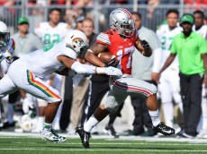 COLUMBUS, OH - SEPTEMBER 12:  Jalin Marshall #17 of the Ohio State Buckeyes eludes the grasp of Benetton Fonua #36 of the Hawaii Rainbow Warriors en route to a long gain in the second quarter at Ohio Stadium on September 12, 2015 in Columbus, Ohio.  (Photo by Jamie Sabau/Getty Images)