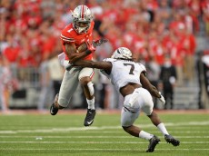 COLUMBUS, OH - SEPTEMBER 26:  Braxton Miller #1 of the Ohio State Buckeyes leaps to avoid the tackle attempt from Ronald Zamort #7 of the Western Michigan Broncos in the fourth quarter at Ohio Stadium on September 26, 2015 in Columbus, Ohio. Ohio State defeated Western Michigan 38-12.   (Photo by Jamie Sabau/Getty Images)