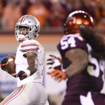 Sep 7, 2015; Blacksburg, VA, USA; Ohio State Buckeyes wide receiver Braxton Miller (1) runs for a touchdown as Virginia Tech Hokies linebacker Andrew Motuapuaka (54) defends in the third quarter at Lane Stadium. Mandatory Credit: Bob Donnan-USA TODAY Sports