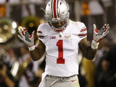 Sep 7, 2015; Blacksburg, VA, USA; Ohio State Buckeyes wide receiver Braxton Miller (1) celebrates after scoring a touchdown against the Virginia Tech Hokies in the third quarter at Lane Stadium. Mandatory Credit: Geoff Burke-USA TODAY Sports
