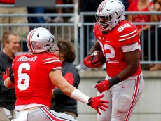 Sep 26, 2015; Columbus, OH, USA; Ohio State Buckeyes defensive lineman Adolphus Washington (92) celebrates his interception return for a touchdown with teammate Sam Hubbard (6) during the second quarter at Ohio Stadium. Ohio State leads the game 24-6. Mandatory Credit: Joe Maiorana-USA TODAY Sports