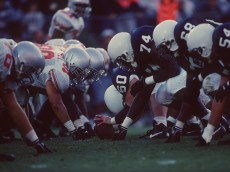 29 Oct 1994: A general view of the line of scrimmage as the offensive line of the Penn State Nittany Lions sets their feet in preparation to block the defensive lineman from the Ohio State Buckeyes during a play in the Nittany Lions 63-14 victory over the