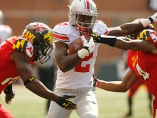 COLLEGE PARK, MD - OCTOBER 04:  Dontre Wilson #2 (C) of the Ohio State Buckeyes stiff-arms cornerback William Likely #4 (R) of the Maryland Terrapins during the first half of Ohio State's 52-24 win at Byrd Stadium on October 4, 2014 in College Park, Maryland.  (Photo by Jonathan Ernst/Getty Images)
