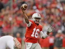 COLUMBUS, OH - OCTOBER 18:  Quarterback J.T. Barrett of the Ohio State Buckeyes completes a pass in the first quarter against the Rutgers Scarlet Knights on October 18, 2014 at Ohio Stadium in Columbus, Ohio.  (Photo by Jamie Sabau/Getty Images)