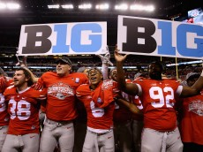 INDIANAPOLIS, IN - DECEMBER 06:  Evan Spencer #6, Adolphus Washington #92 and the Ohio State Buckeyes celebrate after they defeated the Wisconsin Badgers 59-0 in the Big Ten Championship at Lucas Oil Stadium on December 6, 2014 in Indianapolis, Indiana.  (Photo by Andy Lyons/Getty Images)