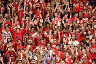 TUCSON, AZ - JANUARY 26:  Fans in the Arizona Wildcats student section cheer during the college basketball game against the Utah Utes at McKale Center on January 26, 2014 in Tucson, Arizona. The Wildcats defeated the Utes 65-56.  (Photo by Christian Petersen/Getty Images)