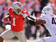 COLUMBUS, OH - OCTOBER 10:  Braxton Miller #1 of the Ohio State Buckeyes is facemasked by Jalen Brooks #43 of the Maryland Terrapins in the first quarter at Ohio Stadium on October 10, 2015 in Columbus, Ohio.  (Photo by Jamie Sabau/Getty Images)